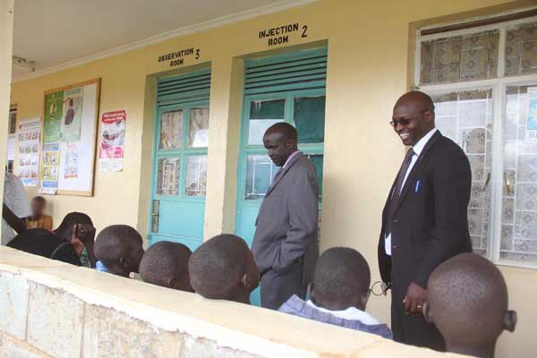 Sila Boit, Uasin Gishu County Executive for Health (right) and Dr Evans Kiprotich, Director of Health Services in the county talks to boys from Kapsoya Estate in Eldoret Town at the Kapsoya Health Centre on April 22, 2015, where they were taken for check-up, after they were allegedly forcefully circumcised by an NGO. PHOTO | JARED NYATAYA | NATION MEDIA GROUP